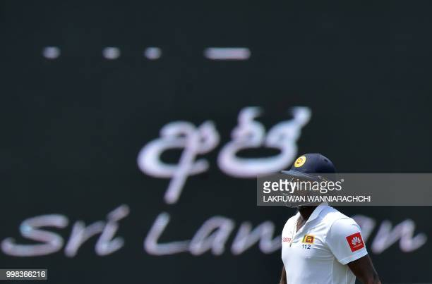 Sri Lanka's Angelo Mathews walks back to the pavilion after his dismissal during the third day of the opening Test match between Sri Lanka and South...