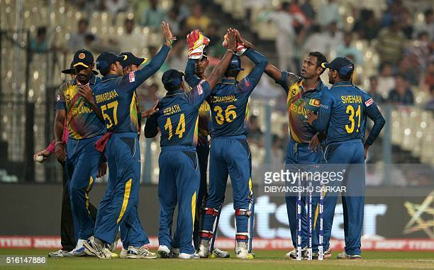 Sri Lanka's Angelo Mathewscelebrates with teammates after the dismissal of unseen Afghanistan batsman Mohammad Shahzad during the World T20 cricket...