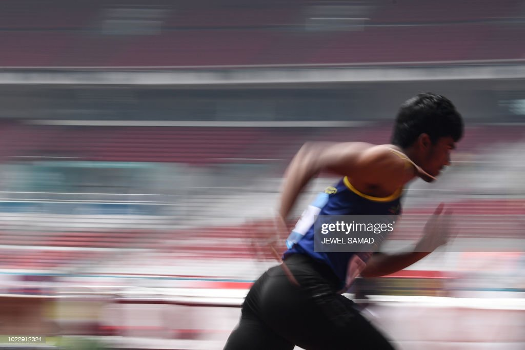 Sri Lanka's Aruna Singhapurage competes in a heat of the