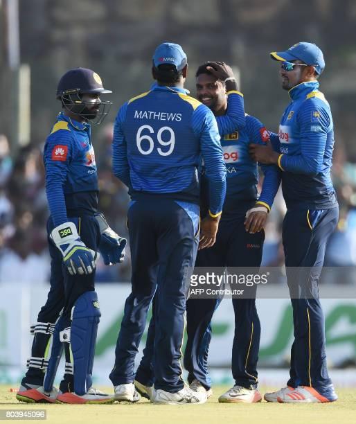 Sri Lanka's Asela Gunaratne celebrates with his teammates after he dismissed Zimbabwe's Solomon Mire during the first oneday international cricket...
