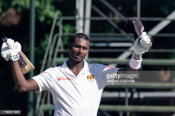 Sri Lanka's batsman Angelo Mathews celebrates reaching 200 runs during the fourth day of the first Test cricket match between Zimbabwe and Sri Lanka...