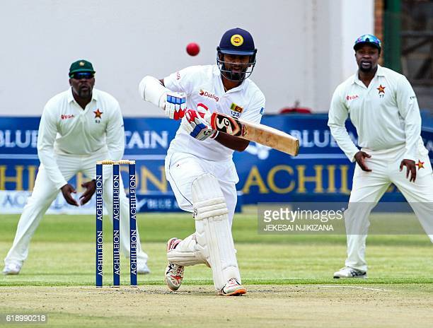 Sri Lanka's batsman Dimuth Karunaratne plays a shot during the first match in a series of two cricket Test matches between Sri Lanka and hosts...