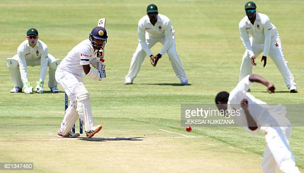 Sri Lanka's batsman Dimuth Karunaratne plays during the first day of the second and last cricket test match between Zimbabwe and Sri Lanka at the...