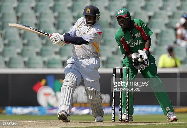 Sri Lanka's batsman Sanath Jayasuriya plays a shoot as Kenyan Maurice Ouma wicketkeeper looks on during the Twenty20 cricket world championship match...