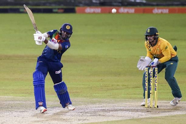 Sri Lanka's Bhanuka Rajapaksa plays a shot as South Africa's wicketkeeper Quinton de Kock looks on during the second international Twenty20 cricket...