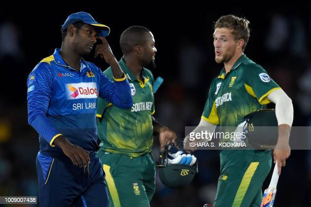 Sri Lanka's captain Angelo Mathews reacts as South Africa's Willem Mulder and Andile Phehlukwayo celebrate after South Africa won by four wickets in...