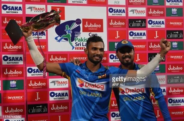 Sri Lanka's captain Dasun Shanaka celebrates as he holds a trophy during the third and final Twenty20 International cricket match between Pakistan...
