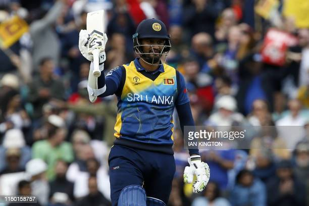 Sri Lanka's captain Dimuth Karunaratne celebrates reaching 50 runs during the 2019 Cricket World Cup group stage match between Sri Lanka and...