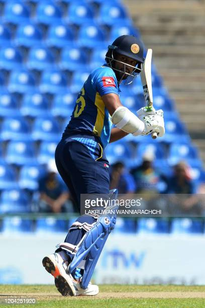Sri Lanka's Captain Dimuth Karunaratne plasy a shot during the third one day international cricket match between Sri Lanka and West Indies at the...