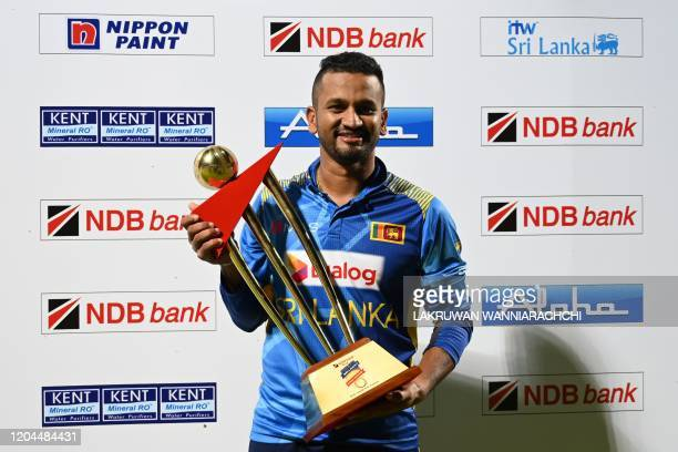 Sri Lanka's Captain Dimuth Karunaratne poses with the trophy after victory in the third one day international cricket match between Sri Lanka and...