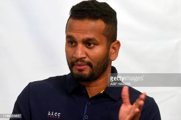 Sri Lanka's captain Dimuth Karunaratne speaks during an open media session in Karachi on December 16 2019 ahead of the second cricket Test match...