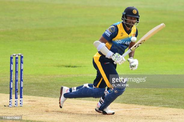 Sri Lanka's captain Dimuth Karunaratne takes a run during the 2019 Cricket World Cup warm up match between Australia and Sri Lanka at the Rose Bowl...