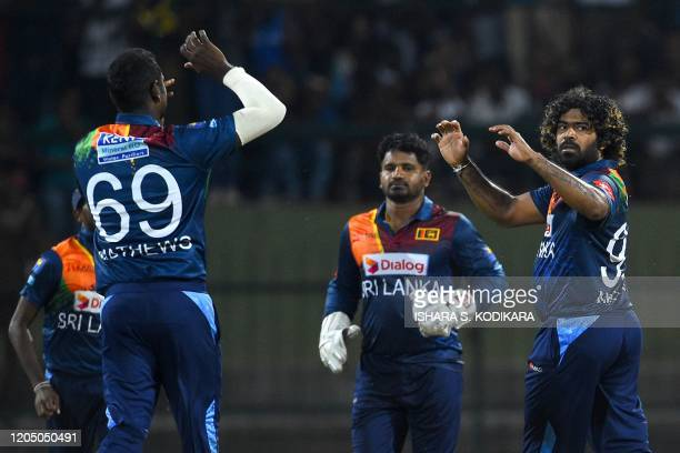 Sri Lanka's captain Lasith Malinga celebrates with his teammates after dismissing West Indies' Andre Russell during the first Twenty20 international...