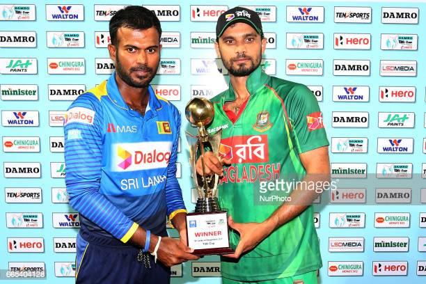 Sri Lanka's captain Upul Tharanga amp Bangladesh's captain Mashrafe Mortaza pose with the T20 trophy at R Premadasa International cricket stadium...