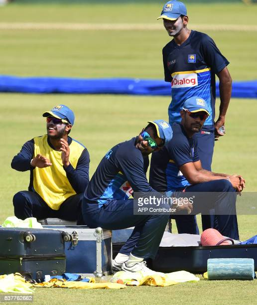 Sri Lanka's captain Upul Tharanga Kusal Mendis Danushka Gunathilaka and Dushmantha Chameera take part in a practice session at the Pallekele...