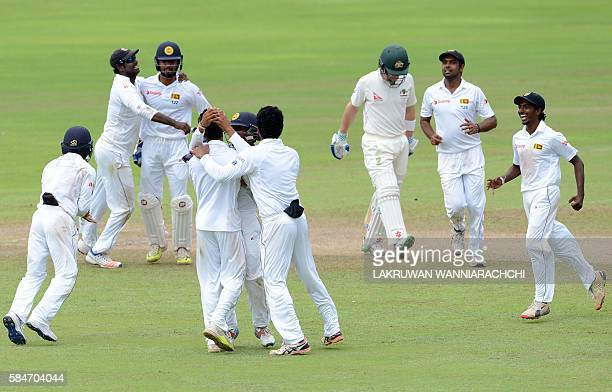 Sri Lanka's celebrates after he dismissed Australia's Peter Nevill during the fifth and the final day of their opening Test match between Sri Lanka...