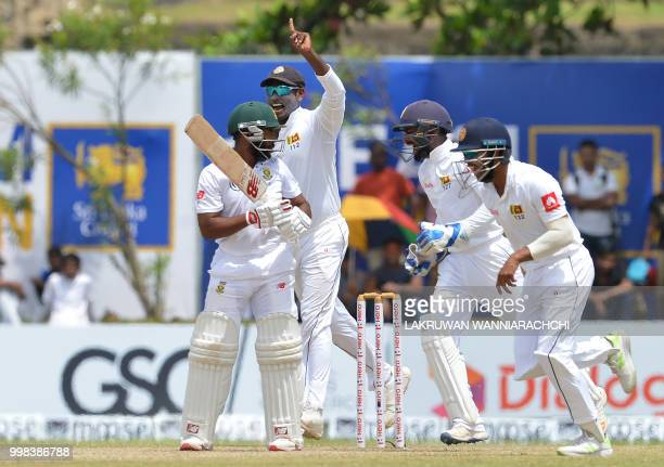 Sri Lanka's celebrates after the dismissmal of South Africa's Temba Bavuma during the third day of the opening Test match between Sri Lanka and South...