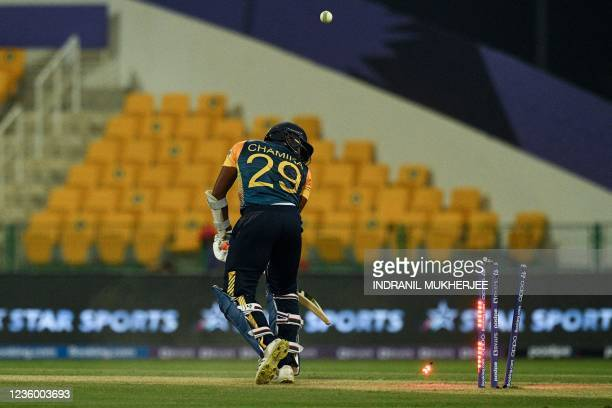 Sri Lanka's Chamika Karunaratne looks back after being bowled out by Ireland's Mark Adair during the ICC mens Twenty20 World Cup cricket match...