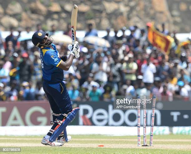 Sri Lanka's cricket captain Angelo Mathews reacts after being dismissed by Zimbabwe's Solomon Mire during the first oneday international cricket...