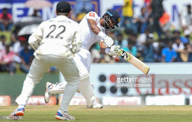 Sri Lanka's cricket captain Dimuth Karunaratne plays a shot during the final day of the opening Test cricket match between Sri Lanka and New Zealand...