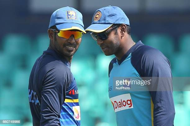 Sri Lanka's cricket captain Upul Tharanga and former captain Angelo Matthews during a practice session at the Sinhalease Sports Club Ground in...