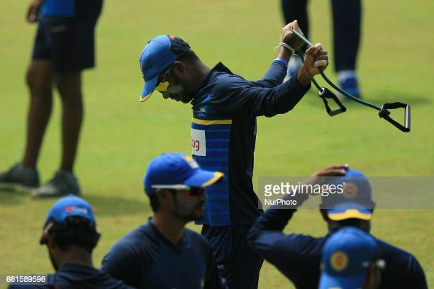 Sri Lanka's cricket captain Upul Tharanga stretches during a practice session at the Sinhalease Sports Club Ground in Colombo on March 31 2017 ahead...