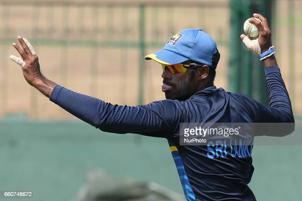 Sri Lanka's cricket captain Upul Tharanga throws a ball during a practice session at the Sinhalease Sports Club Ground in Colombo on March 30 2017 in...
