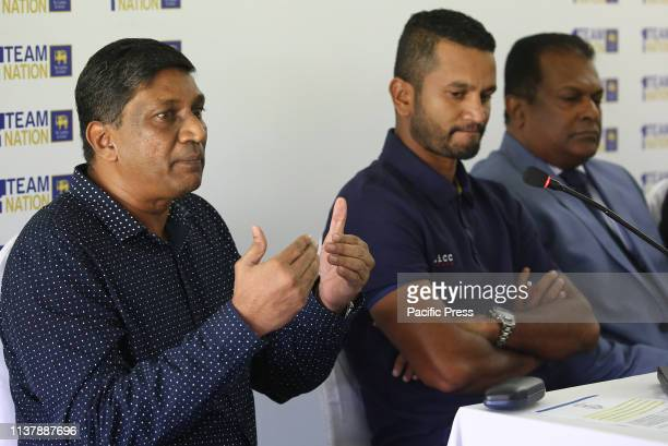 Sri Lanka's Cricket chairman of selectors Ashantha de Mel speaks as newly appointed captain Dimuth Karunaratne looks on during a press conference in...