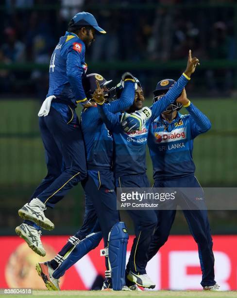 Sri Lanka's cricketer Akila Dananjaya celebrates with his teammates after he dismissed India's Axar Patel during the second One Day International...