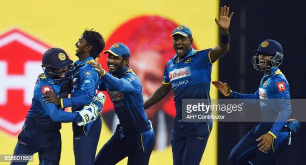 Sri Lanka's cricketer Akila Dananjaya celebrates with teammates after he dismissed Indian cricket Lokesh Rahu during the second One Day International...