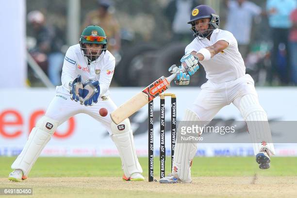 Sri Lanka's cricketer Kusal Mendis plays a shot during the first day of the opening Test match between Sri Lanka and Bangladesh at the Galle...
