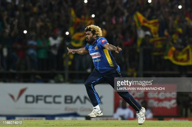Sri Lanka's cricketer Lasith Malinga celebrates a hat-trick after dismissing New Zealand's cricketer Colin de Grandhomme during the third and final...