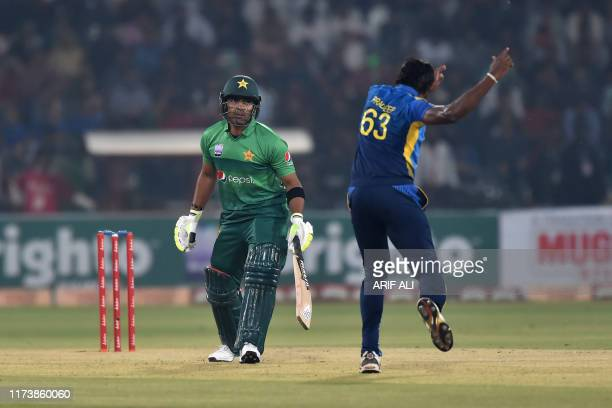 Sri Lanka's cricketer Nuwan Pradeep successful appeal for leg before wicket pas Pakistan's cricketer Kamran Akmalduring the first Twenty20...