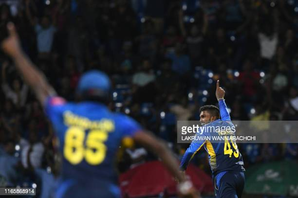 Sri Lanka's cricketer Wanidu Hasaranga celebrates with his teammates after he dismissed New Zealand's cricketer Tom Bruce during the second...