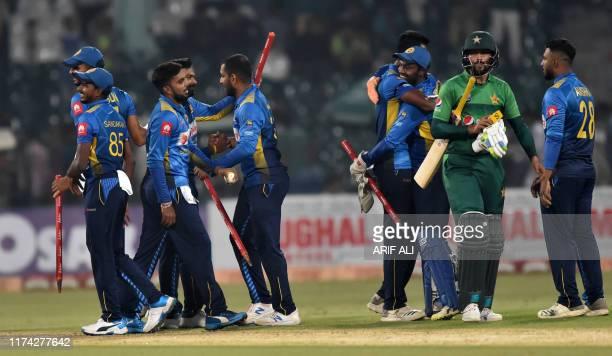 Sri Lanka's cricketers celebrate after beating Pakistan during the second Twenty20 International cricket match between Pakistan and Sri Lanka at the...