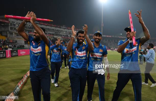 Sri Lanka's cricketers celebrate after beating Pakistan during the third and final Twenty20 International cricket match between Pakistan and Sri...