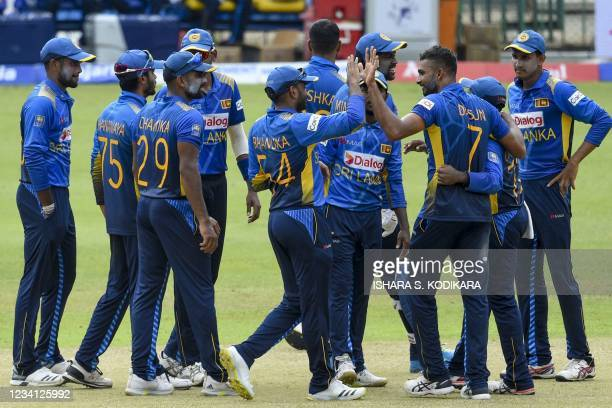 Sri Lanka's cricketers celebrate after the dismissal of India's Prithvi Shaw during the third one-day international cricket match between Sri Lanka...