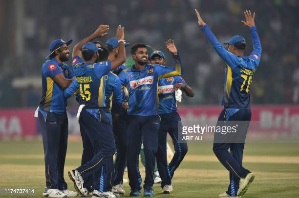 Sri Lanka's cricketers celebrate after the dismissal of Pakistan's batsman Babar Azam during the third and final Twenty20 International cricket match...