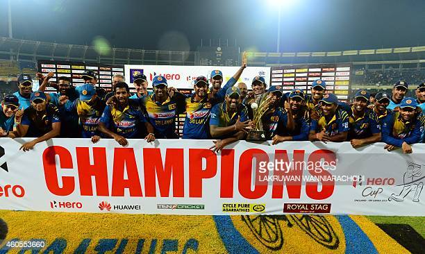 Sri Lanka's cricketers celebrate after winning the seventh and final One Day International cricket match against England at the R Premadasa Cricket...
