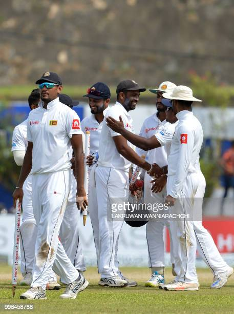 Sri Lanka's cricketers leave the ground led by cricket team captain Suranga Lakmal and teammates after victory in the opening Test match between Sri...