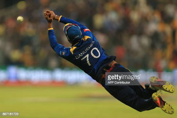 Sri Lanka's Danushka Gunathilaka dives to catch the ball during the second Twenty20 series cricket match Pakistan vs Sri Lanka on October 27 2017 at...