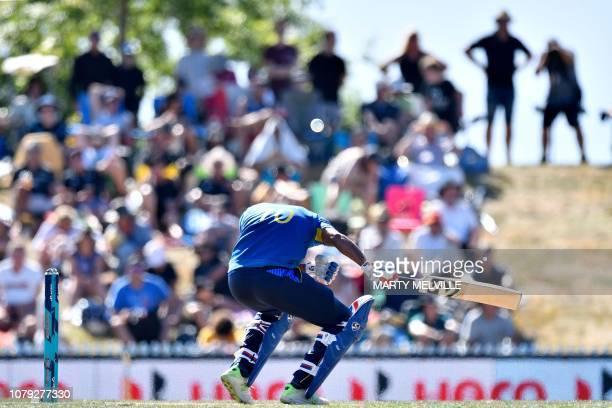 Sri Lanka's Danushka Gunathilaka ducks a bouncer during the third ODI cricket match between New Zealand and Sri Lanka at Saxton Field in Nelson on...