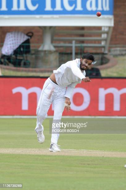Sri Lanka's Dhananjaya de Silva bowls during the second day of their test cricket match against South Africa at St George's Park Stadium on February...
