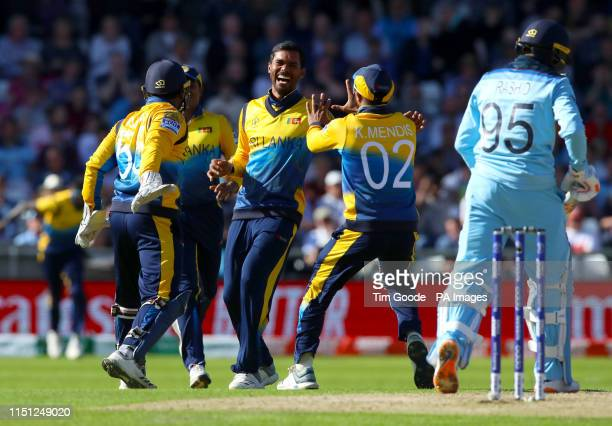 Sri Lanka's Dhananjaya de Silva celebrates taking the wicket of England's Adil Rashid during the ICC Cricket World Cup group stage match at...
