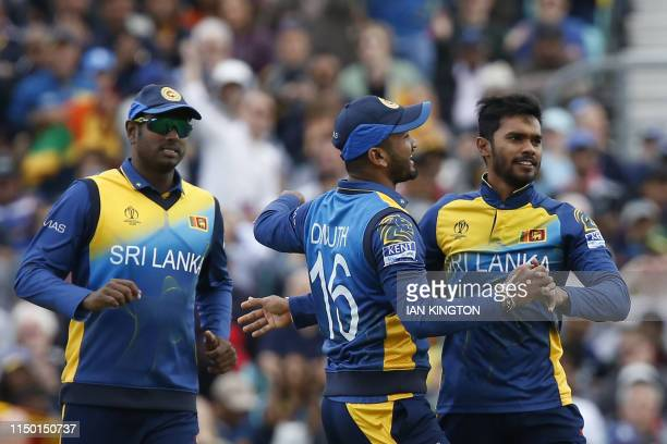 Sri Lanka's Dhananjaya de Silva celebrates the wicket of Australia's David Warner for 26 during the 2019 Cricket World Cup group stage match between...