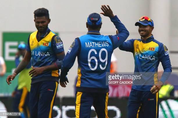 Sri Lanka's Dhananjaya de Silva celebrates with Sri Lanka's Isuru Udana and Sri Lanka's Angelo Mathews after taking the wicket of South Africa's...