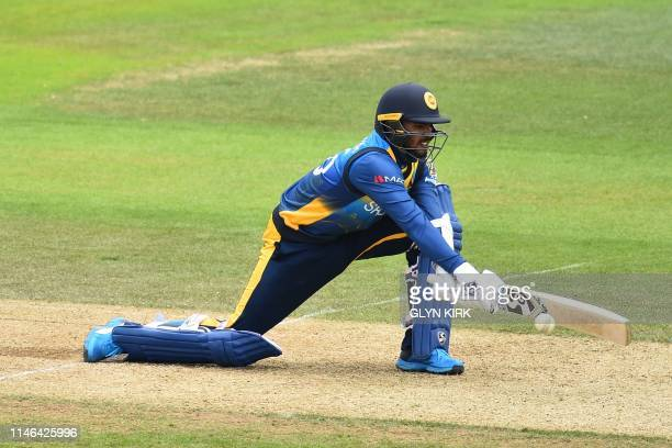 Sri Lanka's Dhananjaya de Silva plays a reverse sweep shot during the 2019 Cricket World Cup warm up match between Australia and Sri Lanka at the...