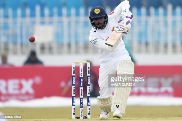 Sri Lanka's Dhananjaya de Silva plays a shot during the second day of the first Test cricket match between Pakistan and Sri Lanka at the Rawalpindi...