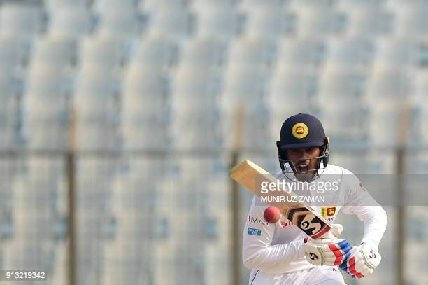 TOPSHOT Sri Lanka's Dhananjaya de Silva plays a shot during the third day of the first cricket Test between Bangladesh and Sri Lanka at Zahur Ahmed...