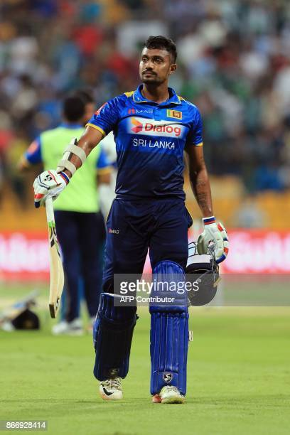Sri Lanka's Dhanushka Gunathilaka walks from the field after being dismissed during the first T20 cricket match between Sri Lanka and Pakistan at the...